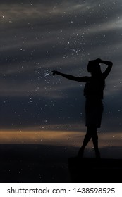 beautiful girl stretches to the stars