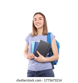 Beautiful girl student with a backpack holds notebooks in hands isolated on a white background