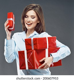 Beautiful girl student hold red gift box. Young business woman.