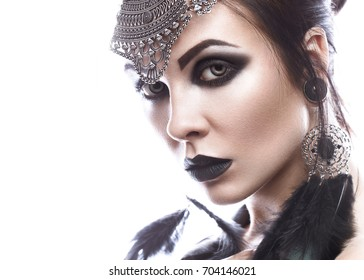Beautiful girl in style of black queen. Image for a Halloween. Photos shot in the studio on a white background.
