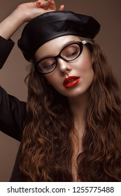Beautiful girl in stylish clothes with glasses for vision. Beauty face. Photo taken in the studio