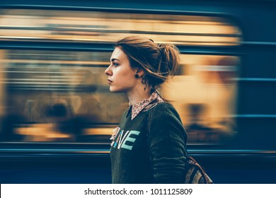 Beautiful girl in the subway and moving train