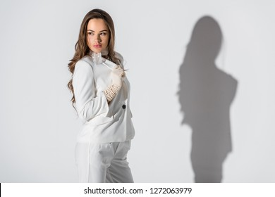beautiful girl in suit posing on white background