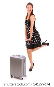 Beautiful girl with suitcase isolated on white