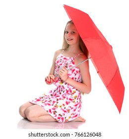 Beautiful girl in a summer dress under an umbrella. The concept of a happy childhood, summer outdoor recreation, happiness, people, beauty and fashion. Isolated on white background.