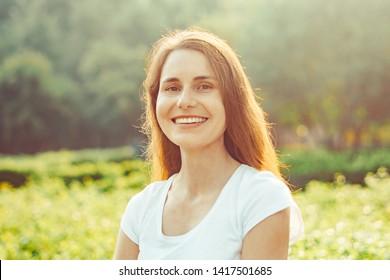 beautiful girl in the sun on the street