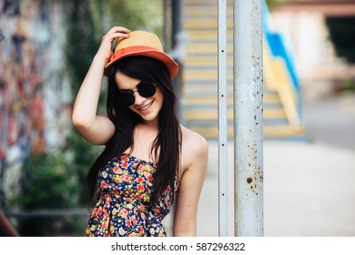beautiful girl in sunglasses posing for the camera in the city
