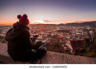 Beautiful girl and sunset, winter landscape on Christmas Xmas advent in city Graz, Austria, Europe.