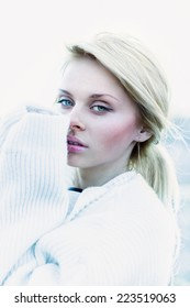 Beautiful girl in sweater freezing outdoor close-up portrait