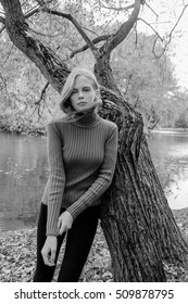 beautiful girl in a sweater in the park