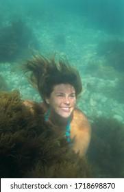 Beautiful girl swimming under water