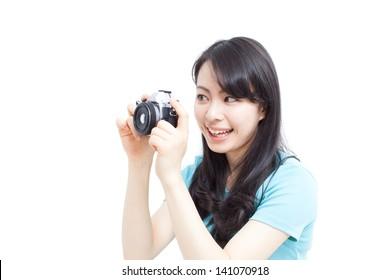beautiful girl taking photos isolated on white background