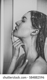 Beautiful girl  is taking a shower