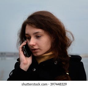 beautiful girl talking on the phone/mobile connection/talk on the telephone
