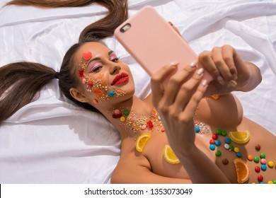 Beautiful girl topless with caramel bodyart shot