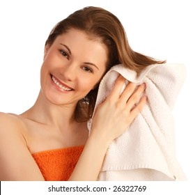 Beautiful girl in a towel. Isolated on white