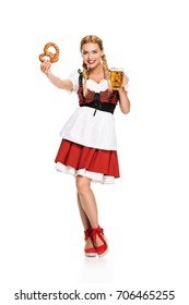 beautiful girl in traditional german costume with pretzel and beer on Oktoberfest, isolated on white
