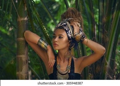 beautiful girl in turban in tropics