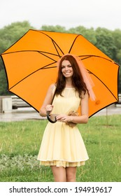 Beautiful girl with umbrella at  park.