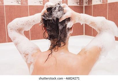 Beautiful girl under shower in bath room