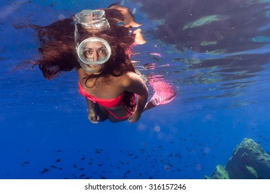 a beautiful girl underwater in the Mediterranean Sea
