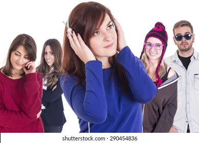 Beautiful girl using headphones with group