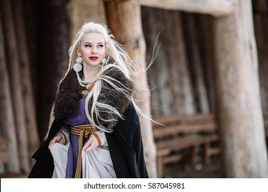 Beautiful girl viking, historic figure, black cloak