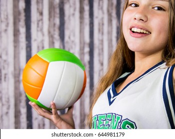Beautiful girl with volleyball.