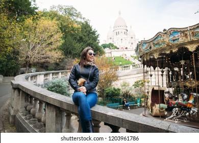 Beautiful girl is walkin in paris near the basilica
