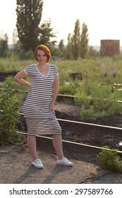 Beautiful girl walking on the railroad