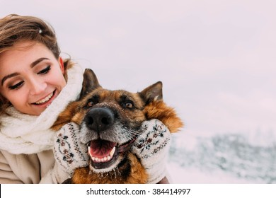 Beautiful girl walking on a winter walk with her big dog