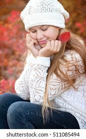 Beautiful girl walking outdoors in autumn