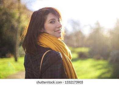 Beautiful girl walking in a park