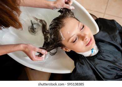 Beautiful girl washing their hair.