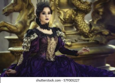 A beautiful girl wearing a beautiful princess,Cute pretty girl in a princess costume. Pretty girl preparing for a costume party.