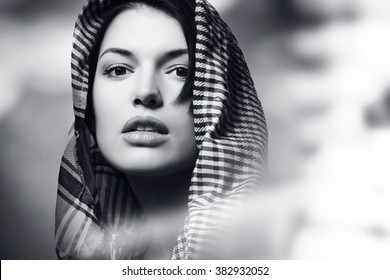 beautiful girl wearing a scarf, portrait, black and white