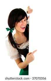Beautiful Girl Wearing A Traditional Costume For Oktoberfest And St Patrick's Day Holding A Blank Sign With Copy Space