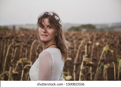 Beautiful girl with white dress in field without makeup plain and simple image