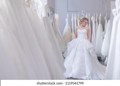 Beautiful girl in a white dress in wedding shop