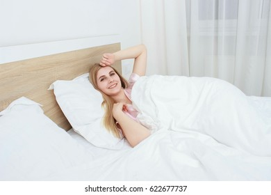 A beautiful girl With white hair resting on the bed