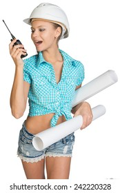 Beautiful girl in white helmet, shorts and shirt holding scrolls drawings and talking on walkie-talkie. Isolated over white background