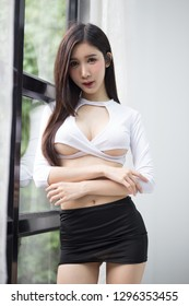 Beautiful girl in white shirt and black miniskirt cosplay, office lady cosplay concepts.