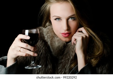 The beautiful girl with a wine glass