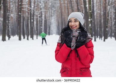 beautiful girl in the winter forest