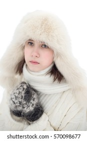 beautiful girl in a winter white cap and a jumper on white