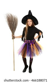 Beautiful girl witch with a broom on a white background