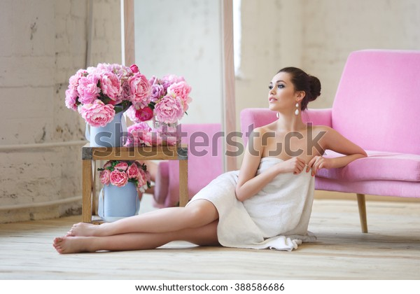 Beautiful girl wrapped in a towel in white and pink intrerere