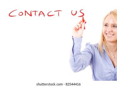 "Beautiful girl writing ""contact us"" on the screen"