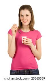 Beautiful girl with yogurt. Isolated on white
