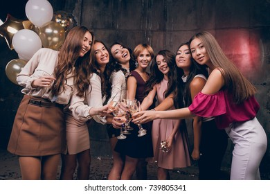 Beautiful girlfriends looking at the camera and smiling. Celebrate Christmas Ewe in the club with friends. New Year holiday with best friends.